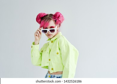 woman with pink hair in sunglasses