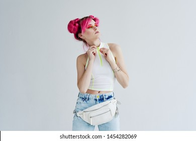 woman with pink hair with a white bag half-length