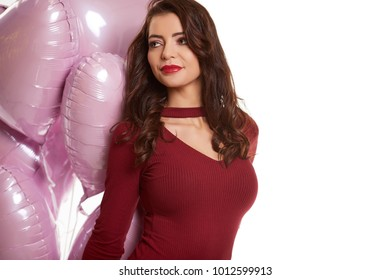 woman with pink heart balloon on a white background