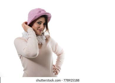 woman with a pink knit cap posing on a white background
