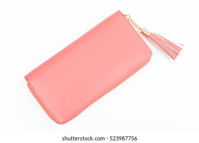 Woman pink purse isolated on the white background. Closeup of modern pink leather wallet over white background. Top view on the wallet.