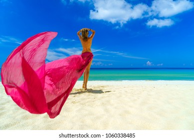 Woman with pink sarong on the tropical beach, Luxury beach travel vacation