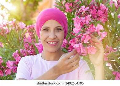 Woman with pink scarf on the head. Cancer awareness