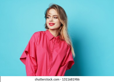woman in a pink shirt on a blue background