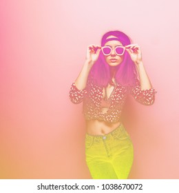 Woman in pink sunglasses, a shirt  and jeans. Minimal trend. Spring style in clothes. the double exposure effect with yellow gradient