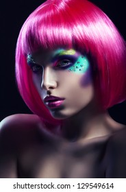 woman in pink wig in dark