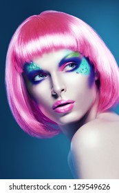 woman in pink wig on blue background