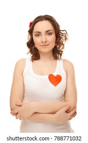 Woman with a pinned red paper heart isolated on white