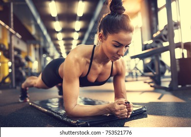 Woman in plank pose in gym