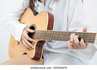woman play guitar close up