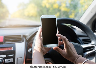 Woman play smartphone while driving. Technology, travel and Security concept