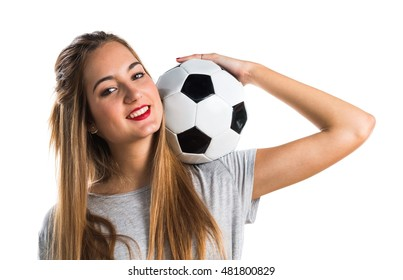 Woman player holding a soccer ball