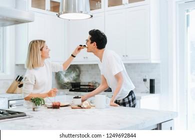 Woman playfully feeding her boyfriend