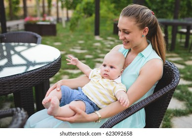 woman playing with baby at yard