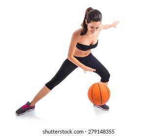 Woman playing baktetball