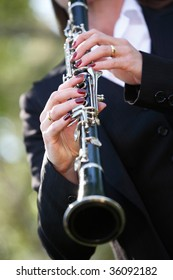 a woman playing clarinet