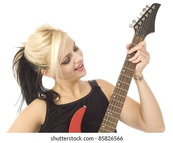 Woman playing electric guitar isolated on white