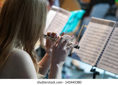 Woman playing the flute during a chamber concert
