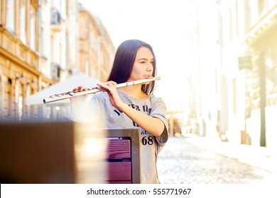 Woman playing flute in town
