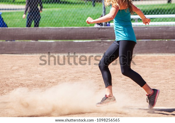 A Woman Playing a Game of Kickball