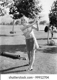 Woman playing golf on a golf course