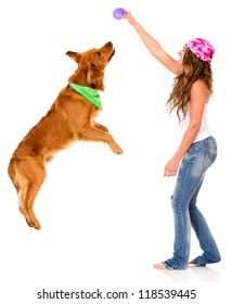 Woman playing with her dog - isolated over a white background