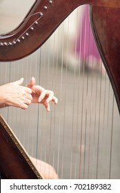 Woman playing on an irish harp