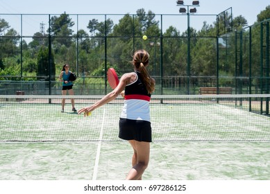 Woman playing padel outdoor