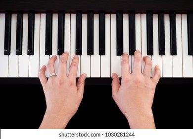 Woman playing piano. Top view with black isolate background. Art and music background. Favorite classic music instrument.