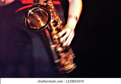 woman playing the sax, photography at low shutter speed, to give rhythm sensation,  Impressionist photographs of musicians,