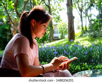 Woman playing smart phone for search and chat with her friend.
