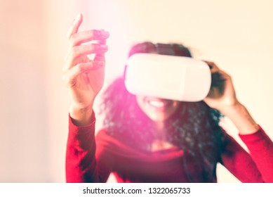 Woman playing with virtual reality glasses.