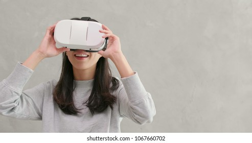 Woman playing VR device