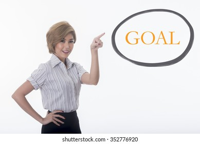 woman pointing at bubble quote with word goal