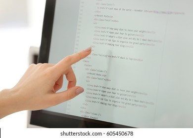 Woman pointing at computer monitor, closeup