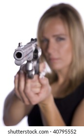 A woman pointing a gun with a serious look on her face.