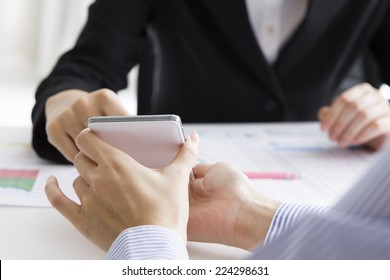 Woman pointing a smart phone
