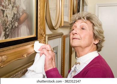 Woman polishing picture frames