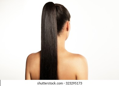 woman with a pony tail on a white