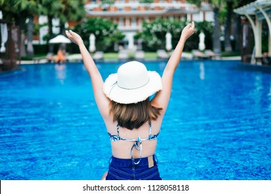 Woman at pool summer concept background.