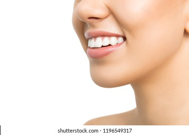 Woman portrait. Dentalcare. Close-up of young woman smiling, isolated on white