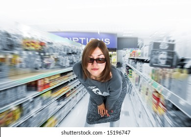 woman portrait in drug store aile blurred
