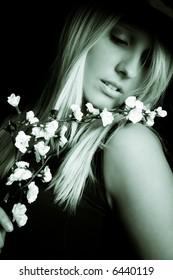 woman portrait with flower, studio in dark