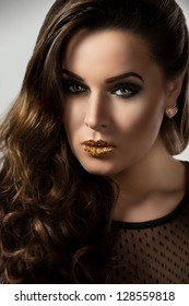 Woman portrait with gold stars make-up