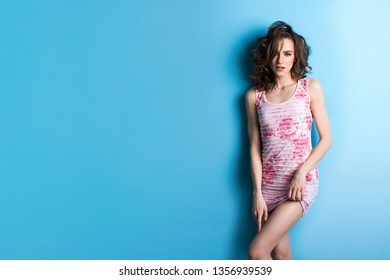 Woman. Portrait of a lady on a blue background.