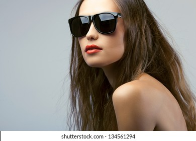 woman portrait with long hair wearing sunglasses