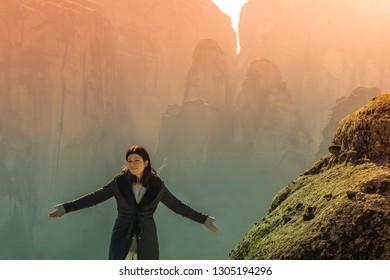Woman portrait at Meteora in Greece. A beautiful landscape view.