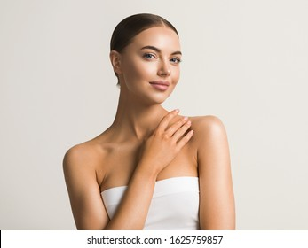 Woman portrait with neck shoulders body beautiful hands manicure collarbone tanned skin natural make up