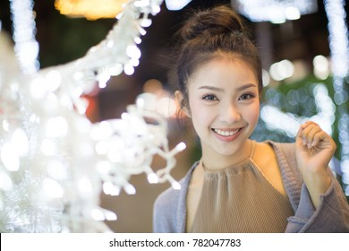 woman portrait in night city lights.portrait of young pretty beautiful woman