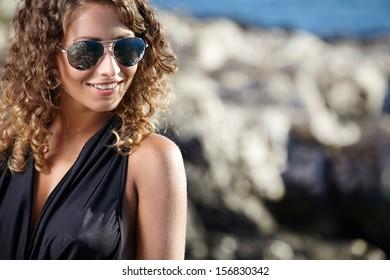 woman portrait on the sea stone